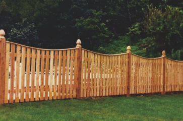 custom-wooden-fence-around-a-pool-with-green-grass-in-the-backyard-in-nice-neighborhood